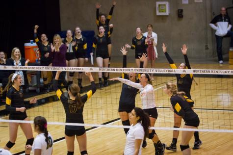 NKU volleyball celebrates their win against Jacksonville. NKU defeated Jacksonville 3-0 on Friday, Oct. 11, 2014 at Regents Hall.