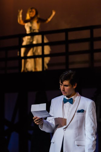 Senior Noah Berry as Robbie Hart reading break-up note from fiancee Linda, played by junior Emily Fry.