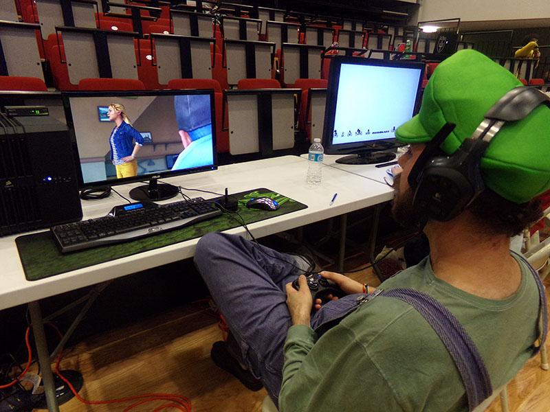 NKU student Steven Middlemas dressed as Luigi plays one of the many games at the MINja's annual charity event.