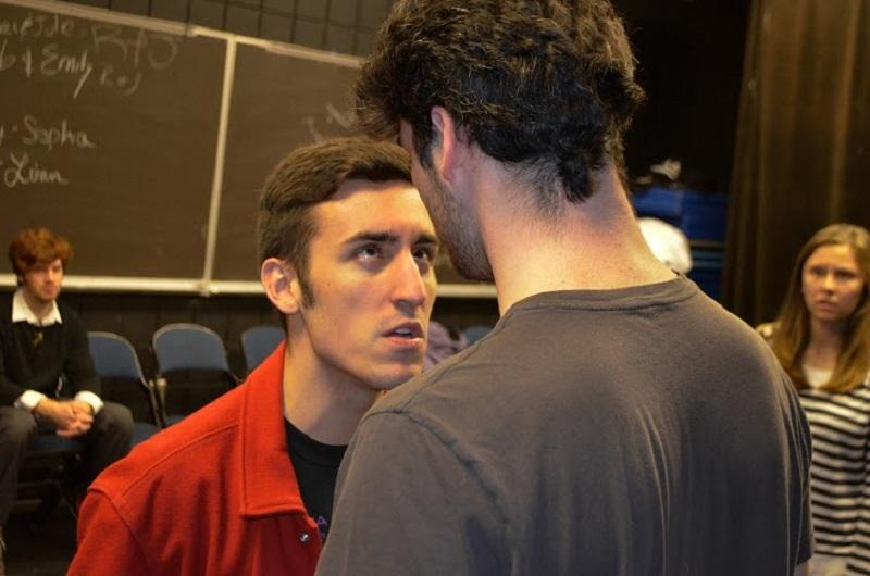 Junior Kyle Taylor as Guy faces off with senior Matt Krieg.