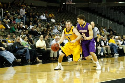 Ethan Faulkner drives to the basket during the 2012-2013 season against Lipscomb University. Faulkner is now an assistant coach for the Norse.