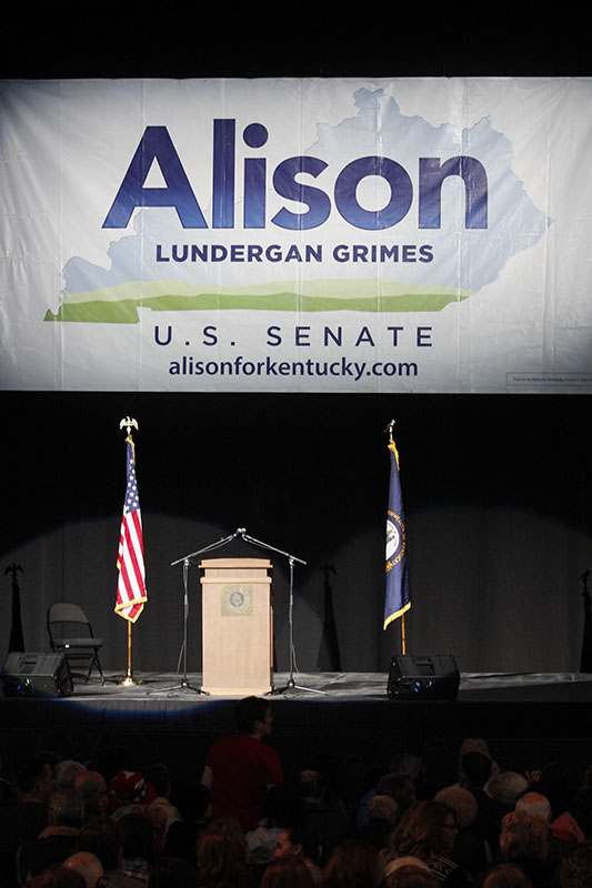 The stage is set at The Bank of Kentucky Center. An audience waited for Alison Lundergan Grimes and other speakers.