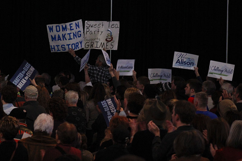 Audience members wave signs in support. About 1,400 people gathered in NKU's Bank of Kentucky Center Saturday morning to show support for Kentucky Democratic senate candidate Alison Lundergan Grimes.