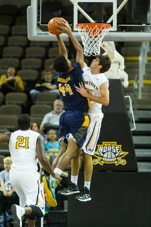 NKU player Cole Murray jumps up to block a North Carolina A&T players shot during the first half of NKU's