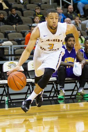 NKU junior Tyler White drives to the basket during NKU's 98-48 win over Ohio Mid-Western. NKU defeated Ohio Mid-Western 98-48 at The Bank of Kentucky Center on Nov. 22, 2014.