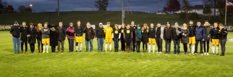 NKU seniors celebrate their last home game with their families. NKU defeated Stetson 1-0 in double overtime at NKU Soccer Stadium on Saturday, Nov. 1, 2014.