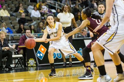 NKU junior Christine Roush passes the ball to a teammate during NKU's 38-45 loss to Loyola (Chicago). NKU lost to Loyola (Chicago) 35-45 at The Bank of Kentucky Center on Nov. 22, 2014.