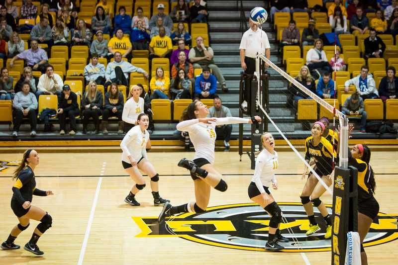 NKU's Keely Creamer jumps up to kill the ball across the net during NKU's 3-0 victory over Kennesaw St. NKU defeated Kennesaw State 3-0 at Regents Hall on NKU Campus on Nov. 14, 2014.