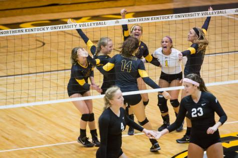 NKU's volleyball team celebrates after a NKU point against Stetson in the third set of NKU's 3-0 win against the Hatters. NKU defeated Stetson 3-0 at Regents Hall on NKU Campus on Saturday, Nov. 1, 2014.
