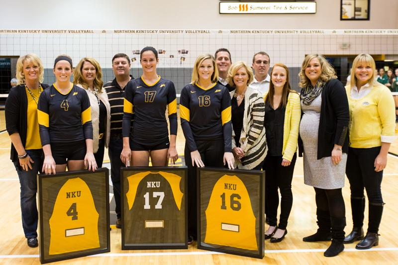NKU seniors, Kiersten Ham (4), Jenna Ruble (17) and Megan Wanstrath (16)  celebrate their Senior Day with their families and coaches. NKU defeated USC Upstate 3-1 on Saturday, Nov. 15, 2014 in Regents Hall on NKU campus.