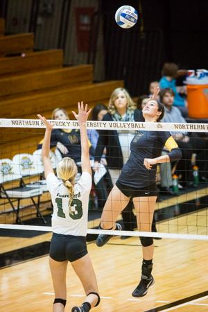 NKU senior, Jenna Ruble spikes the ball against USC Upstate during NKU's victory over Spartans. NKU defeated USC Upstate 3-1 on Saturday, Nov. 15, 2014 in Regents Hall on NKU campus.