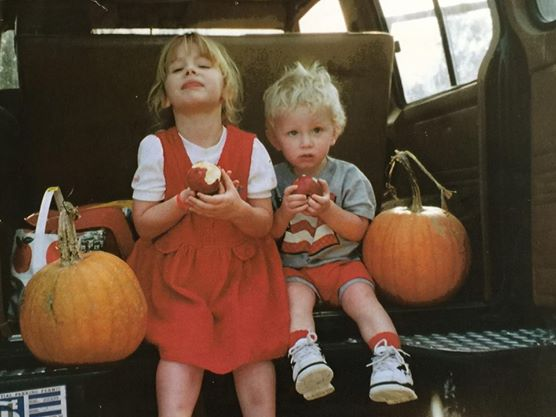 Brook and Ben at a young age after picking pumpkins, a family tradition they continued to do as they grew older.