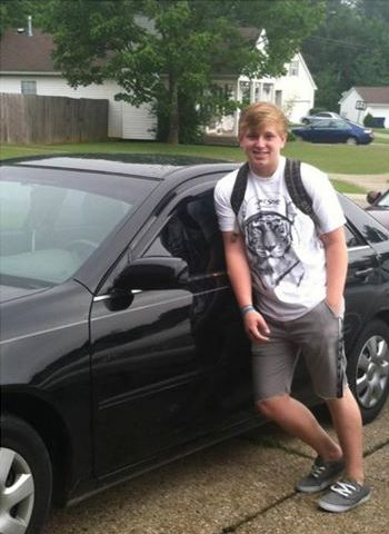 Ben+poses+next+to+his+very+first+car+for+his+first+day+of+his+senior+year+of+high+school.+