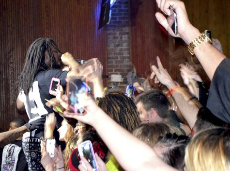 It wasn't long until Waka was off the stage and onto the floor with fans