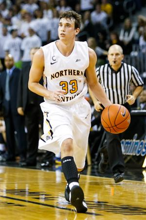 NKU men's basketball player Anthony Monaco dribbles towards the hoop during the second half of NKU's 42-67 loss to West Virginia University. NKU was defeated by West Virginia University 42-67 at The Bank of Kentucky Center on Sunday, Dec. 7, 2014.