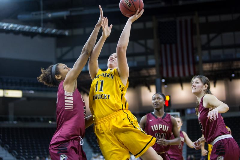 NKU's Melody Doss goes up for a shot during the second half of NKU's win over IUPUI. NKU defeated IUPUI 57-43 at the Bank of Kentucky Center on Tuesday, Dec. 30, 2014.