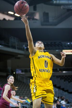 NKU's Shar'RaeDavis goes up for a layup during the second half of NKU's win over IUPUI. NKU defeated IUPUI 57-43 at the Bank of Kentucky Center on Tuesday, Dec. 30, 2014.