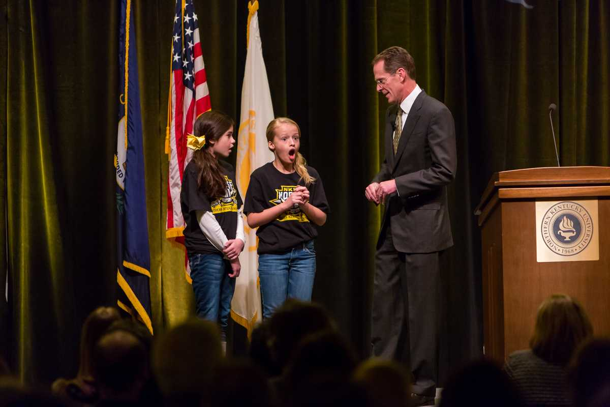 NKU+President+Mearns+awarding+two+middle+school+girls+a+trip+around+campus+and+Cincinnati+during+during+his+2015+Spring+Convocation.+President+Mearns+spoke+about+the+past+year+and+the+upcoming+year+in+the+Student+Union+Ballroom+on+Friday%2C+Jan.+9%2C+2015.