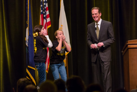 NKU President Mearns awarding two middle school girls a trip around campus and Cincinnati during during his 2015 Spring Convocation. President Mearns spoke about the past year and the upcoming year in the Student Union Ballroom on Friday, Jan. 9, 2015.