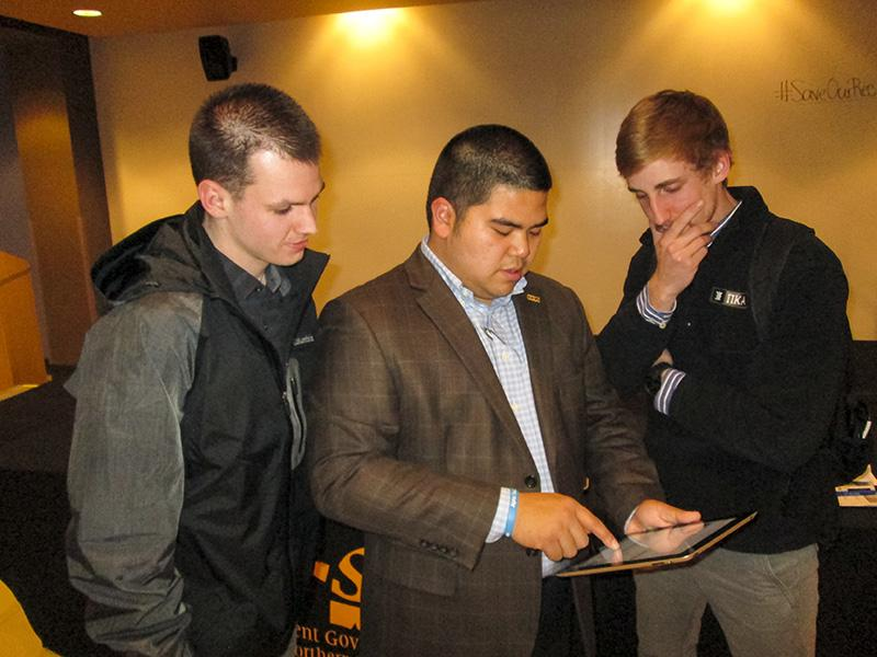 SGA President John Jose shows students how to sign the petition to #SaveOurRec. Jose held a forum Friday, Jan. 23, to discuss recent news of NKU's outsourcing of management for the Campus Recreation Center.