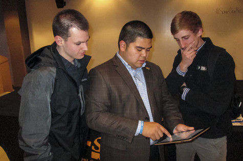 SGA President John Jose shows students how to sign the petition to #SaveOurRec. Jose held a forum Friday to discuss recent rumors of NKU's outsourcing of management for the Campus Recreation Center.