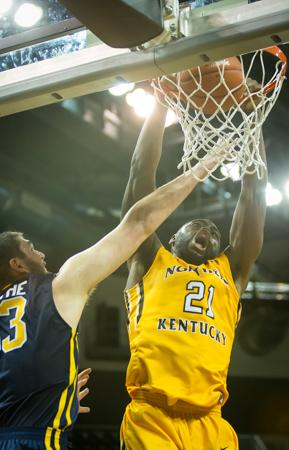NKU's Jalen Billups dunks the ball during NKU's loss to Toledo 57-55. NKU lost to University of Toledo 57-55 on Saturday, Jan. 3, 2015 at The Bank of Kentucky Center.