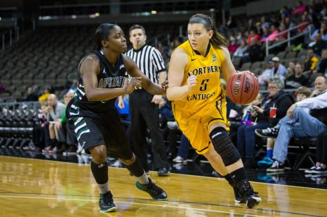 NKU guard Rianna Gayheart (5) and her teammates prepare to open the 2015-16 basketball season Friday at Miami University.