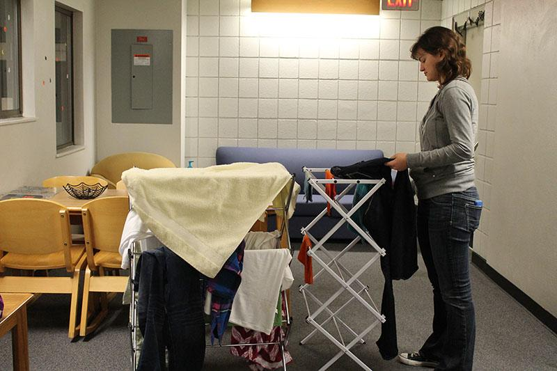 Freshman Elizabeth Gieske hangs wet towels in a hallway of Kentucky Hall to dry. The media informatics major said excessive moisture in her room prevented towels and clothes from drying.