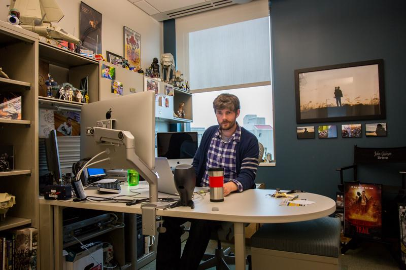 John Gibson sits in his office on the fifth floor of Griffin Hall. Gibson's office is unique because of his toy collection.