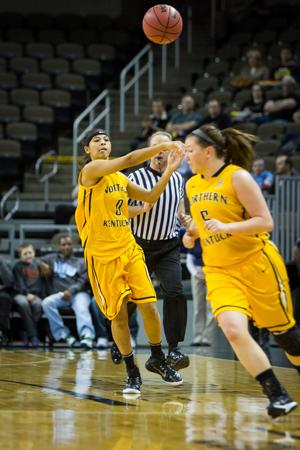 NKU guard Shar'Rae Davis passes the ball to a teammate in NKU's victory over Lipscomb. NKU defeated Lipscomb 64-57 at The Bank of Kentucky Center on Saturday, Feb. 7, 2015.