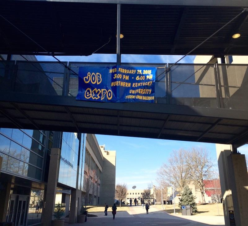 A+Job+Expo+banner+hangs+from+the+breezeway+between+the+Student+Union+and+the+University+Center.+The+Job+Expo+will+take+place+Feb.+25%2C+2015.