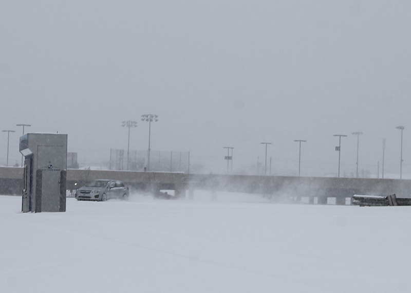 A+car+does+tricks+in+the+snow+in+a+vacant+lot+on+campus.+NKU+was+closed+Monday%2C+Feb.+16+due+to+inclement+weather.