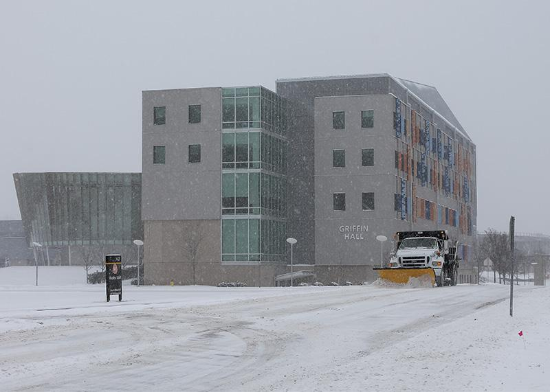 Snow plow trucks work to clear roadways on campus. NKU was closed Monday, Feb. 16 due to inclement weather.