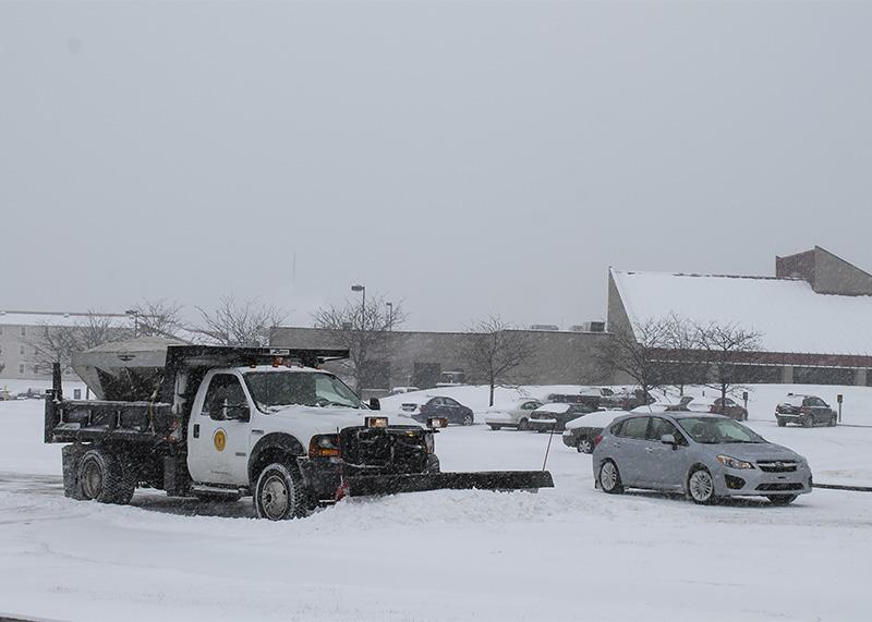 Snow+plow+trucks+work+to+clear+parking+lots+on+camous.+NKU+was+closed+Monday%2C+Feb.+16+due+to+inclement+weather.