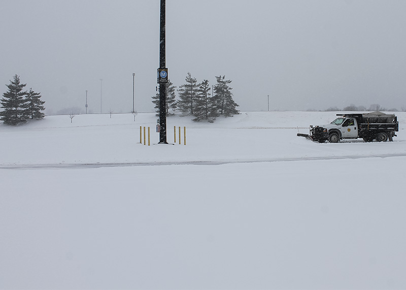 Snow+plow+trucks+work+to+clear+parking+lots+on+campus.+NKU+was+closed+Monday%2C+Feb.+16+due+to+inclement+weather.
