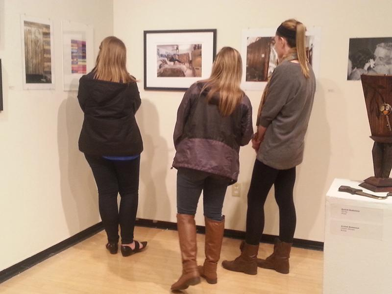 Students browse the gallery.