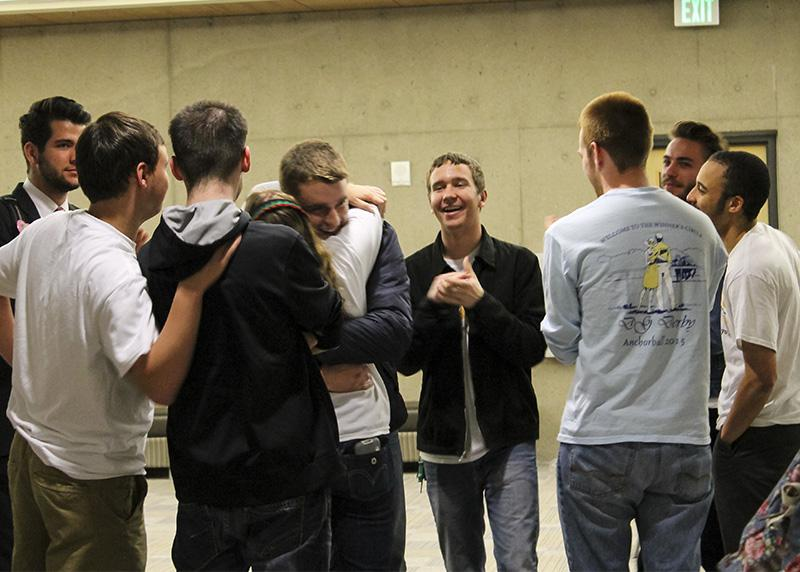Kat Hahnel and Will Weber, President and Vice President elect, embrace in a hug surrounded by friends after the announcement of their win. The duo won with 565 votes.