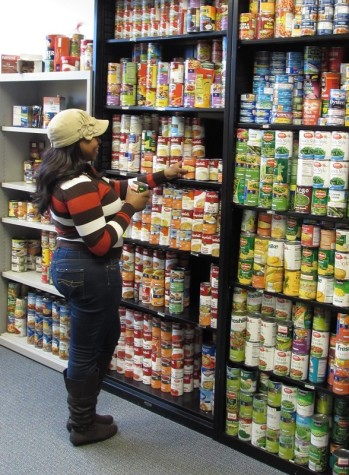 FUEL volunteer and senior social work major Kezia Slaughter stocks shelves at the FUEL NKU food pantry in Founders Hall.