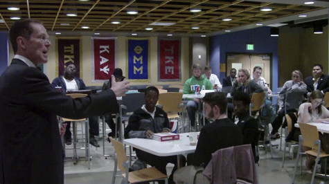 President Mearns speaks to students at Monday's town hall forum. The Rec Center, Health Innovations Center, Peter Gitau's resignation and the national search for a new head basketball coach were the topics of discussion.