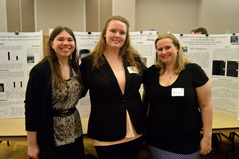Biological science students (from left to right) Jamie Weimer, Josephine Brown and Clare Ludwig stand in front of their poster presentation at NKU's Celebration on Wednesday. The three studied the effects of the chemical taurine on adolescent mice.