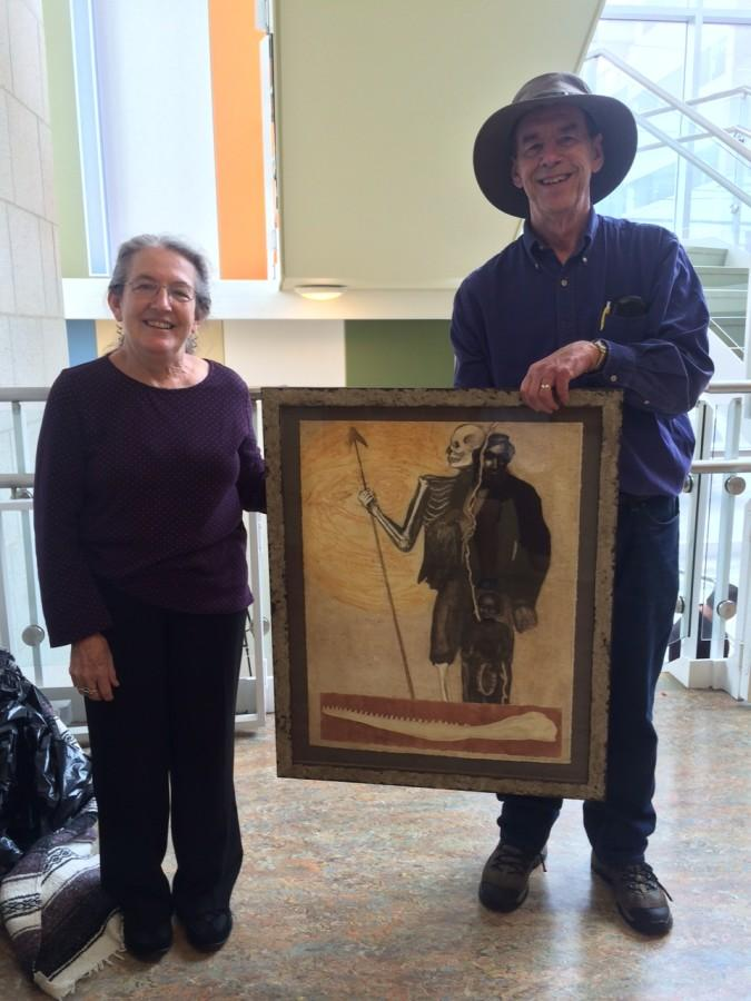 Wallace and Kathleen Piercefield holding up her artwork inspired by the book.