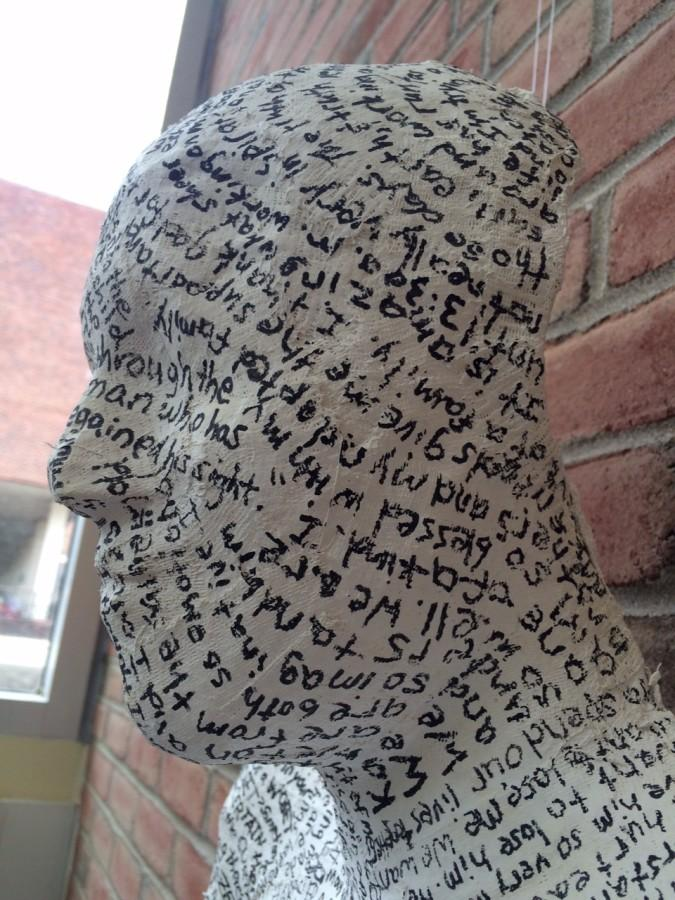 Abby Schlachters cast covered in writing on display at the festival.