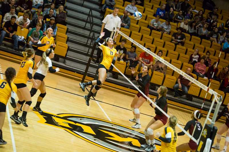 Jenna Ruble goes up for the ball against Eastern Kentucky University. NKU won against them 3-1 on Oct. 28, 2014.