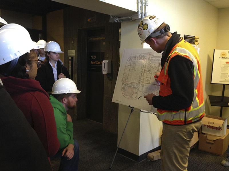 Project Manager JD Barnes shows student government senators the route they will take through the Rec Center construction site. SGA toured the site March 30.