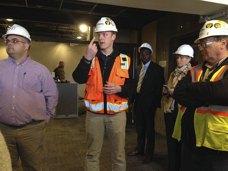 From left to right, Project Manager Brad Lehman, Project Manager JD Barnes and Group Superintendent Joe Deacon discuss some of the new Rec Center features the senators may see on the tour. SGA toured the site March 30.