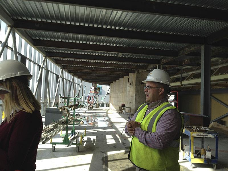 Project Manager Brad Lehman discusses the treadmills that will be installed next to a wall of windows. SGA toured the site March 30.
