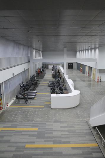 As you first enter the rec area there is a long section with workout machines in it. The space can be looked down into from a study area and the indoor track one it is open.