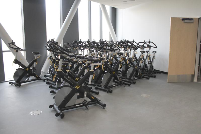 New spinning bikes wait to be used in their new room.