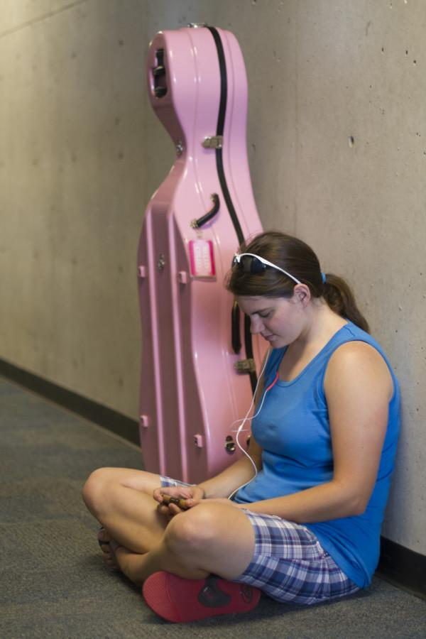 Freshman Nursing major Patricia Iiams sits by her cello