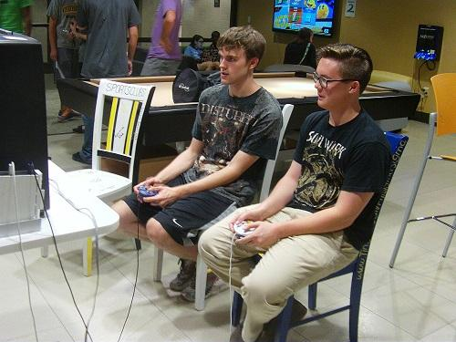 Students play in the Smash Bros Tournament. This is the first tournament of the semester in the game room.